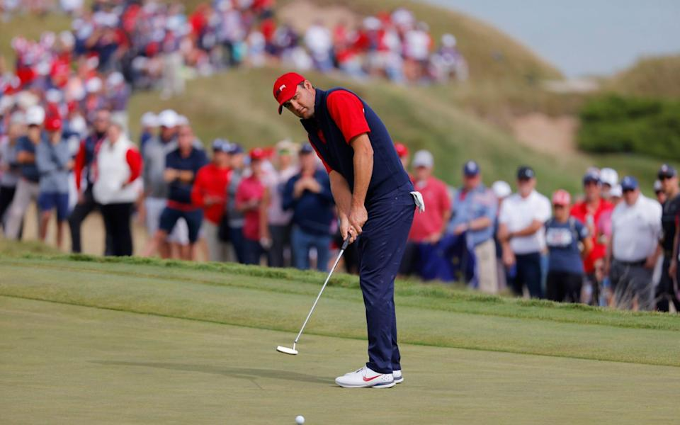 Team USA's Scottie Scheffler hits his putt on the 2nd green during the Singles. - REUTERS/Mike Segar