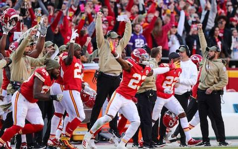 The Kansas City Chiefs bench celebrates after kicking a game winning field goal against the Minnesota Vikings at Arrowhead Stadium - Credit: USA Today