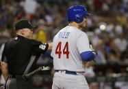 Chicago Cubs' Anthony Rizzo (44) frowns after being called out on strikes by umpire Lance Barksdale, left, during the third inning of a baseball game against the Arizona Diamondbacks on Wednesday, Sept. 19, 2018, in Phoenix. (AP Photo/Ross D. Franklin)