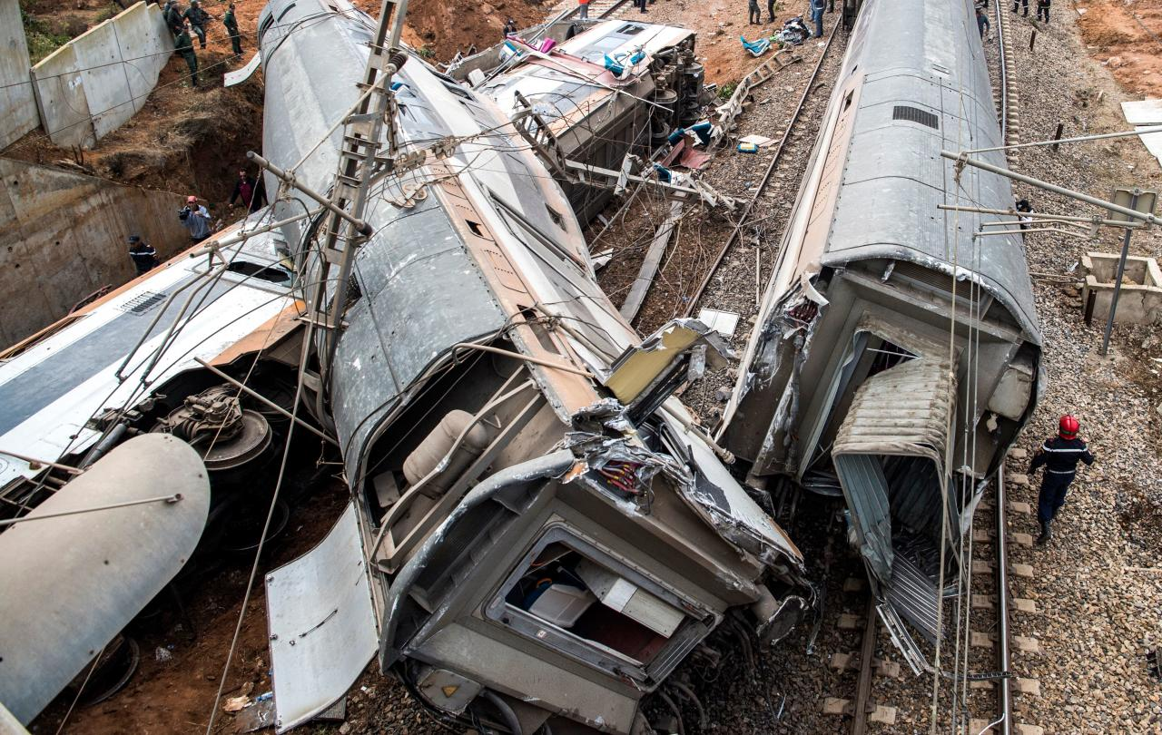 <p>This picture taken on Oct. 16, 2018 shows the scene of a rail accident in the Moroccan town of Bouknadel, between the capital Rabat and the port city of Kenitra to its north. (Photo: Fadel Senna/AFP/Getty Images) </p>
