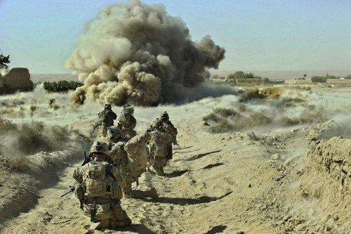 Dust kicks off the ground during an operation by US Army soldiers at Zangabad foward operating base in Panjwai district in September 2012. President Barack Obama is weighing plans to keep roughly 10,000 US troops in Afghanistan after the NATO-led force hands over security to the Afghan government, a senior US official said Monday
