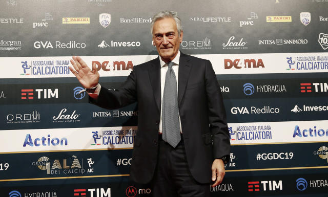 FIGC President Gabriele Gravina poses for photographer as he arrives for the Gran Gala' soccer awards ceremony, in Milan, Italy, Monday, Dec. 2, 2019. (AP Photo/Antonio Calanni)