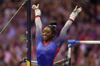 Simone Biles reacts to her performance on the uneven bars during the women's U.S. Olympic Gymnastics Trials Friday, June 25, 2021, in St. Louis. (AP Photo/Jeff Roberson)