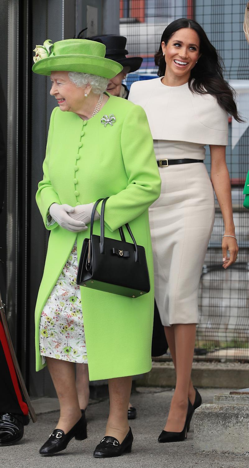 The former Meghan Markle and Queen Elizabeth II.  (PETER BYRNE via Getty Images)