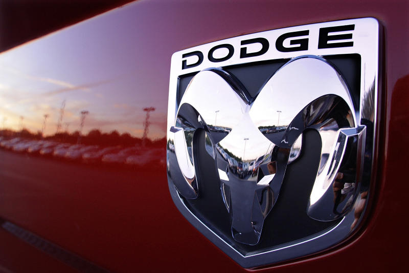 FILE- In this Aug. 15, 2010, file photo the Dodge logo is seen on a new Dodge RAM 3500 Heavy Duty pickup trucks at sunset at a dealership in Springfield, Ill. Fiat Chrysler is recalling more than 1.6 million vehicles worldwide to replace Takata front passenger air bag inflators that can be dangerous. The recall covers the 2010 through 2016 Jeep Wrangler SUV, the 2010 Ram 3500 pickup and 4500/5500 Chassis Cab trucks, the 2010 and 2011 Dodge Dakota pickup, the 2010 through 2014 Dodge Challenger muscle car, the 2011 through 2015 Dodge Charger sedan, and the 2010 through 2015 Chrysler 300 sedan. (AP Photo/Seth Perlman, File)