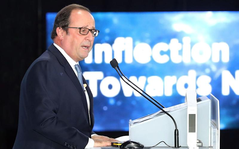 Former French president Francois Hollande speaking at the opening ceremony of the World Knowledge Forum in Seoul - AFP