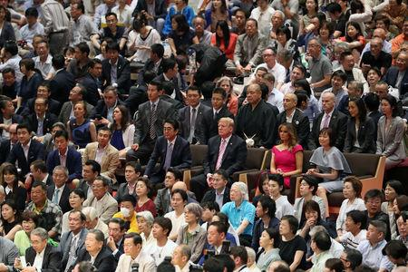U.S. President Donald Trump, first lady Melania Trump, Japanese Prime Minister Shinzo Abe and wife Akie Abe watch the Summer Grand Sumo Tournament at Ryogoku Kokigikan Sumo Hall in Tokyo, Japan May 26, 2019. REUTERS/Jonathan Ernst
