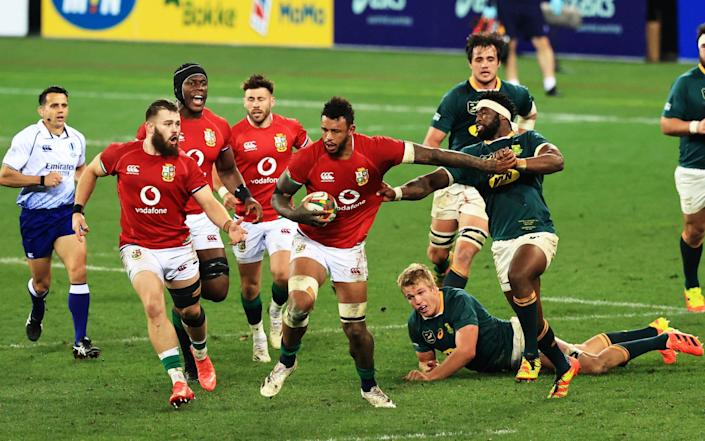 Courtney Lawes of British & Irish Lions hands off Siya Kolisi of South Africa - GETTY IMAGES