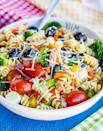 """<p>This easy-to-make pasta salad is full of flavor, and damn, is it good. It's quick to throw together, and the ingredients can be tweaked to include anything you'd like. Feel free to toss in different cheeses, seasonal veggies, fruit, and more. To adjust the recipe for two people, just toggle the slider on the part of the recipe where it says """"servings.""""</p> <p><strong>Get the recipe:</strong> <a href=""""https://www.lovefromtheoven.com/easy-pasta-salad/"""" class=""""link rapid-noclick-resp"""" rel=""""nofollow noopener"""" target=""""_blank"""" data-ylk=""""slk:easy rotini pasta salad"""">easy rotini pasta salad</a></p>"""