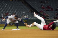 Los Angeles Angels designated hitter Shohei Ohtani, right, is tagged out by Houston Astros second baseman Jose Altuve while trying to steal second during the fourth inning of a baseball game Wednesday, Sept. 22, 2021, in Anaheim, Calif. (AP Photo/Mark J. Terrill)