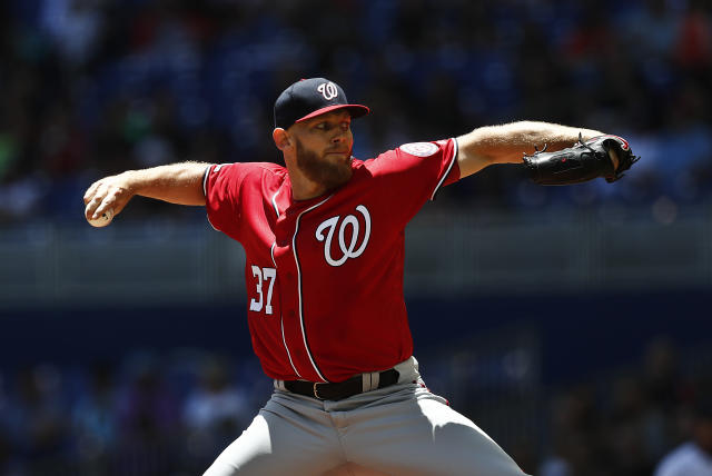 Washington Nationals starting pitcher Stephen Strasburg delivers during the first inning of a baseball game against the Miami Marlins on Sunday, April 21, 2019, in Miami. (AP Photo/Brynn Anderson)