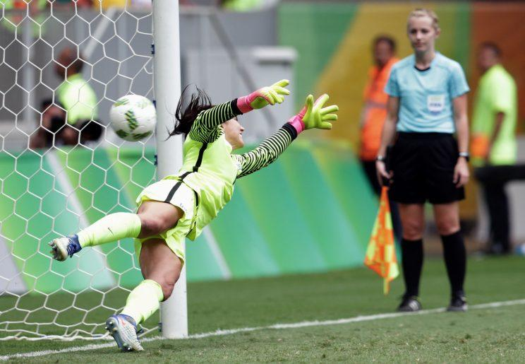 Hope Solo and Team USA were bounced out of the Olympics after suffering a loss to Sweden. (AP)