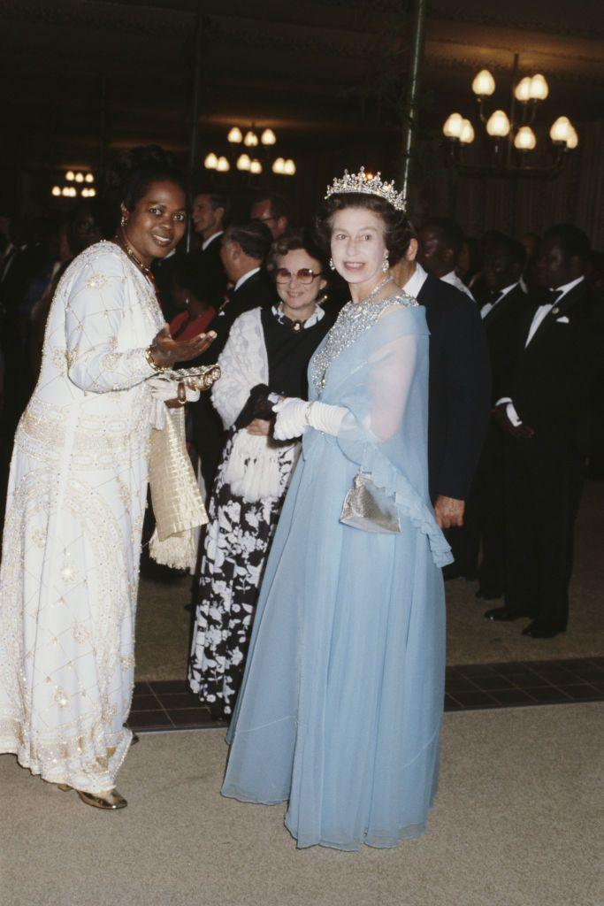 """<p>Queen Elizabeth wore a chiffon evening gown in Cinderella-blue during a state visit to Malawi in 1979. The monarch accessorized with sparkling accessories, including the <a href=""""https://royalwatcherblog.com/2017/07/03/queen-in-malawi/"""" rel=""""nofollow noopener"""" target=""""_blank"""" data-ylk=""""slk:Girls of Great Britain and the Ireland Tiara"""" class=""""link rapid-noclick-resp"""">Girls of Great Britain and the Ireland Tiara</a>. </p>"""