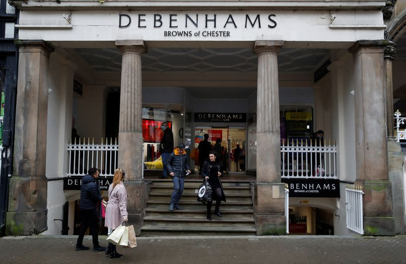 Shoppers walk out of a Debenhams store in Chester, Britain