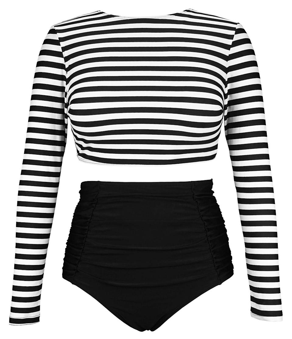 """<strong><em>Cocoship Rashguard High-waisted Bikini</em></strong><br><br>You can also go the more modest-chic route with a full-coverage, long-sleeved top. With over 2,300 reviews and a 4.5-star, we think you might be onto something with this look. """"I freaking LOVE this swimsuit! I have never found a rash guard crop top style. I wear 38DDD, usually L-XL, and size 16. True to size,"""" wrote reviewer Erica Loftin. """"I've gotten lots of compliments and feel confident wearing this suit. Plus I have a sleeve of tattoos that I don't have to keep reapplying sunscreen on bc they're covered and protected with this top.""""<br><br><strong>Cocoship</strong> Rashguard High-Waisted Bikini, $, available at <a href=""""https://amzn.to/33NY84V"""" rel=""""nofollow noopener"""" target=""""_blank"""" data-ylk=""""slk:Amazon"""" class=""""link rapid-noclick-resp"""">Amazon</a>"""