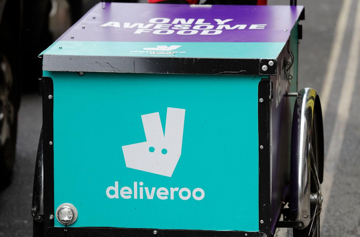 FILE - In this Tuesday, July 11, 2017 file photo, a Deliveroo logo is seen on a bicycle in London. Amazon is investing in British meal delivery company Deliveroo, expanding its reach into food retailing. Deliveroo said Friday May 17, 2019 that it raised $575 million from investors led by Amazon. (AP Photo/Frank Augstein, file)