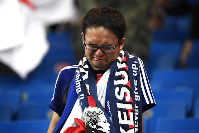 <p>A Japan fan looks dejected following their sides defeat in the 2018 FIFA World Cup Russia Round of 16 match between Belgium and Japan at Rostov Arena on July 2, 2018 in Rostov-on-Don, Russia. (Photo by Carl Court/Getty Images) </p>