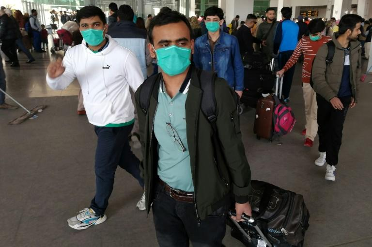 Pakistani students wearing protective face masks arrive from China at Islamabad International Airport. Pakistan is one of the few countriers to maintain flights to China during the crisis