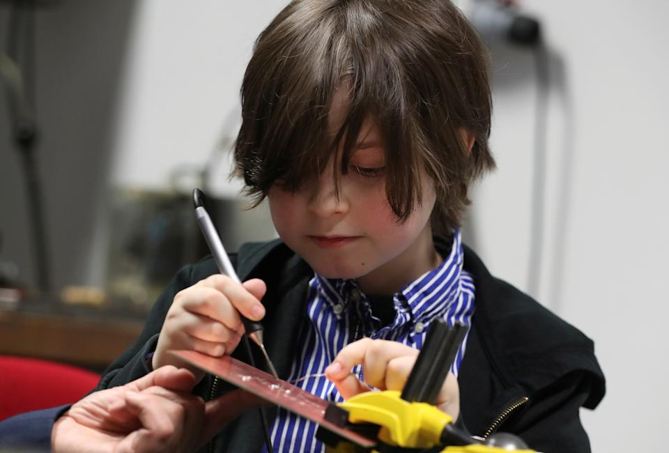 Nine-year-old Belgian student Laurent Simons, who studies electrical engineering and who will soon become the youngest university graduate in the world, is seen in a laboratory at the University of Technology in Eindhoven, Netherlands November 20, 2019.  Picture taken November 20, 2019.  REUTERS/Yves Herman
