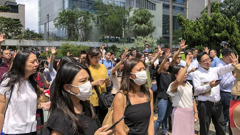 Office workers join singing flash mob on their lunch break as part of Hong Kong protests throughout Mid-Autumn Festival holiday