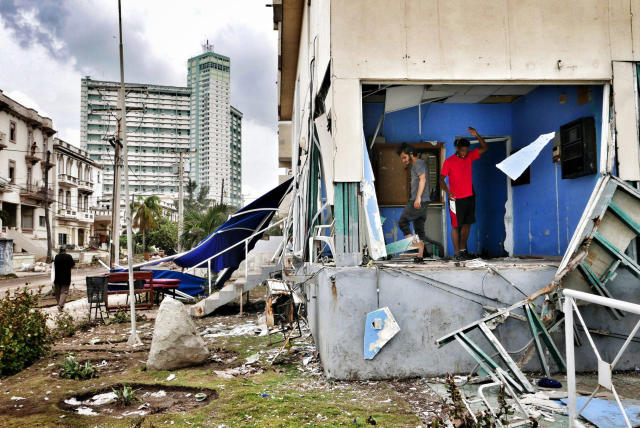 <p>Cubans clean their houses after the flooding, three days after Hurricane Irma passed over Cuba, on Sept. 12, 2017, in Havana, Cuba. Hundreds of thousands still have no power as Cuba is recovering from the impact by hurricane Irma. (Photo: Sven Creutzmann/Mambo photo/Getty Images) </p>