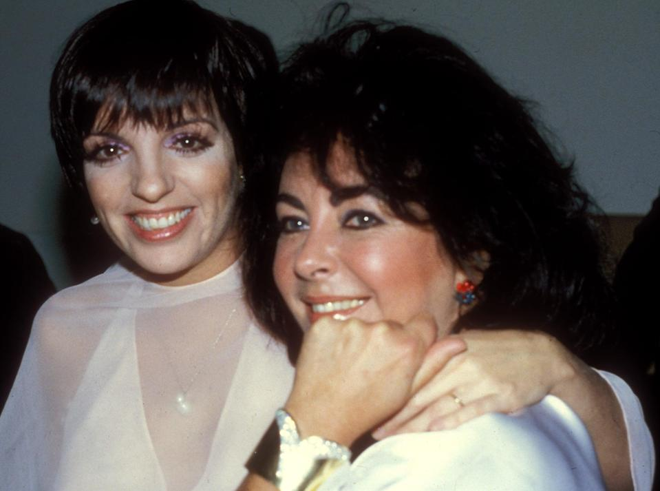 <p>Liza married sculptor Mark Gero at St. Bartholomew's Church in New York. Here she poses with Elizabeth Taylor at her reception. (Elizabeth stood in for Liza's mom, Judy Garland, who passed in 1969, during the ceremony.) Liza opted for an off-white plunging dress with a sheer overlay and a pearl necklace.</p>