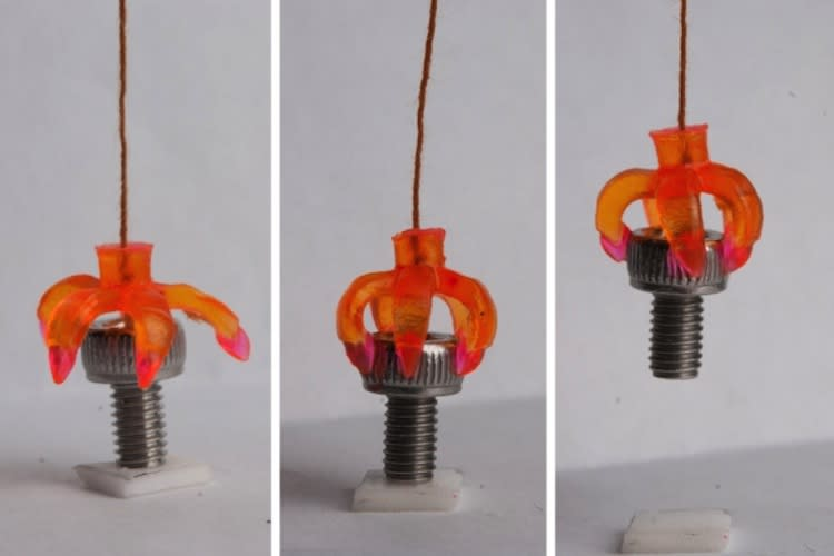 A 3D-printed minigripper, consisting of shape-memory hinges and adaptive touching tips, grasps a cap screw.