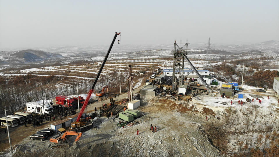 In this photo released by China's Xinhua News Agency, rescuers work at the site of a gold mine that suffered an explosion in Qixia in eastern China's Shandong Province, Wednesday, Jan. 13, 2021. Authorities have detained managers at a gold mine in eastern China where more than 20 workers have been trapped underground following an explosion Sunday. (Wang Kai/Xinhua via AP)
