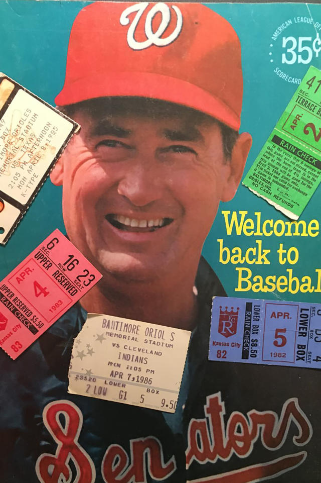 The Washington Senators 1969 opening day program featuring Ted Williams, adorned with ticket stubs from opening days in the 1980's is shown in New York, Monday, March 23, 2020. To baseball fans, opening day is an annual rite of springthat evokes great anticipation and warm memories. This year's season was scheduled to begin Thursday, March 26, 2020, but there will be no games for a while because of the coronavirus outbreak. (AP Photo/Ben Walker)
