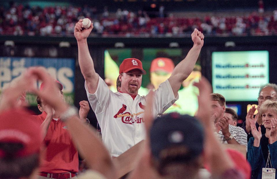 Mark McGwire celebrates after hitting his 62nd home run in 1998.