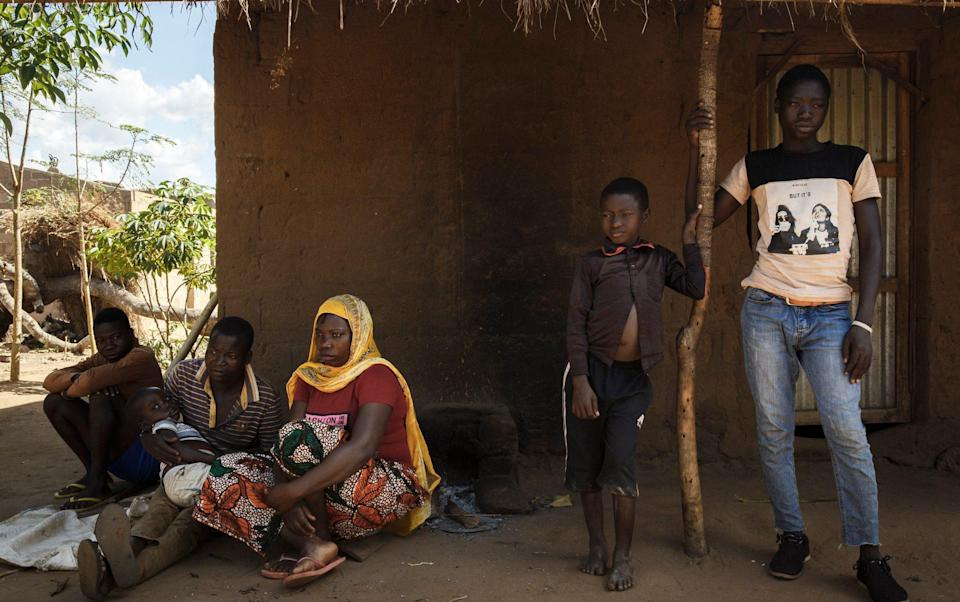 Julio (on the far right) next to his little brother ouside their foster home in Cabo Delgado. - Ed Ram