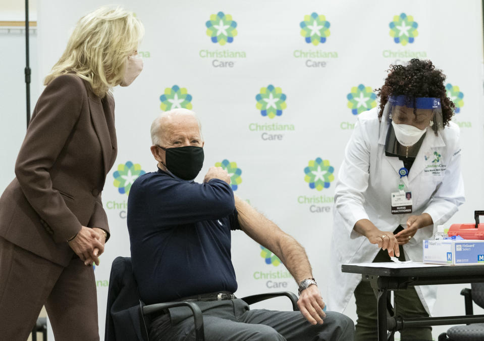 President-elect Joe Biden, joined by his wife Jill Biden, rolls up his sleeve to receive his first dose of the coronavirus vaccine from Nurse partitioner Tabe Mase at Christiana Hospital on live television in Newark Del., Monday, Dec. 21, 2020. (AP Photo/Carolyn Kaster)
