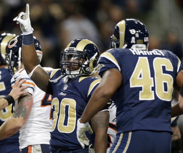 St. Louis Rams running back Zac Stacy, left, is congratulated by teammate Cory Harkey (46) after scoring on a 1-yard run during the first quarter of an NFL football game against the Chicago Bears on Sunday, Nov. 24, 2013, in St. Louis. (AP Photo/Nam Y. Huh)