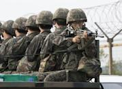 Koreas agree to defuse crisis after marathon talks
