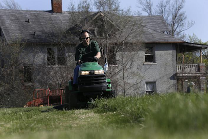 Mower Gang member Andrew Haig, of Birmingham, mow at Duweke Park in Detroit, Wednesday May 1, 2013. The Mower Gang, a group of volunteer lawn mower riders, adopt parks beginning in the spring and keep them free of high-grass throughout the summer. (AP Photo/Paul Sancya)