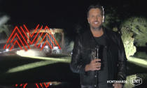 In this video image provided by CMT, Luke Bryan introduces a performance during the Country Music Television awards airing on Wednesday, Oct. 21, 2020. (CMT via AP)