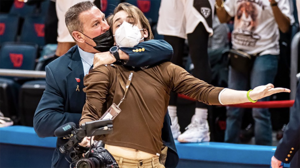 A security guard from the University of Dayton Arena was caught on camera putting a cameraman, who was permitted on court to film post game celebrations, in a chokehold. Picture: Griffin Quinn/Twitter/@griffinpquinn