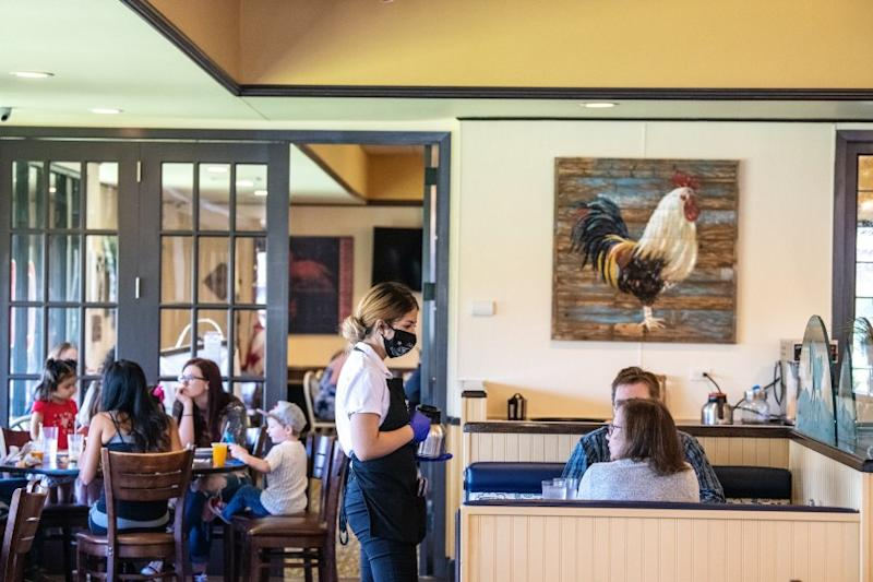 NORCO, CA - MAY 19: The scene inside The Original Pancake House on Tuesday, May 19, 2020 in Norco, CA. Owner Vince Kikugawa opened the doors to dine in customers last week and says he's taking every precaution possible and following CDC guidelines. Some of the changes to his restaurant include: limiting the amount of seating, washable menus, sanitizing each table thoroughly-this includes sanitizing the backs of seats, having patrons wait outside or in their cars until a seat is available, as well as face covering and gloves for all staff members. (Mariah Tauger / Los Angeles Times)