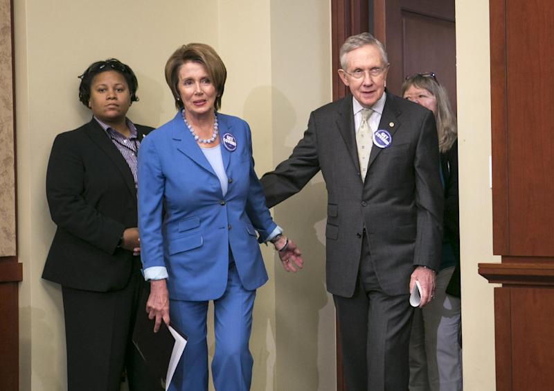House Minority Leader Nancy Pelosi of Calif., and Senate Majority Leader Harry Reid of Nev., arrive on Capitol Hill in Washington, Tuesday, Oct. 1, 2013, for an event to celebrate the start of the Affordable Care Act, popularly known as Obamacare, with other lawmakers and people whose lives have been impacted by lack of health insurance. (AP Photo/J. Scott Applewhite)