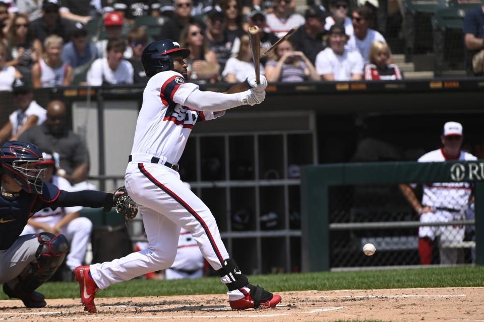 Chicago White Sox's Brian Goodwin (18) breaks his bat during the second inning of a baseball game against the Cleveland Indians, Sunday, Aug. 1, 2021, in Chicago. (AP Photo/Matt Marton)