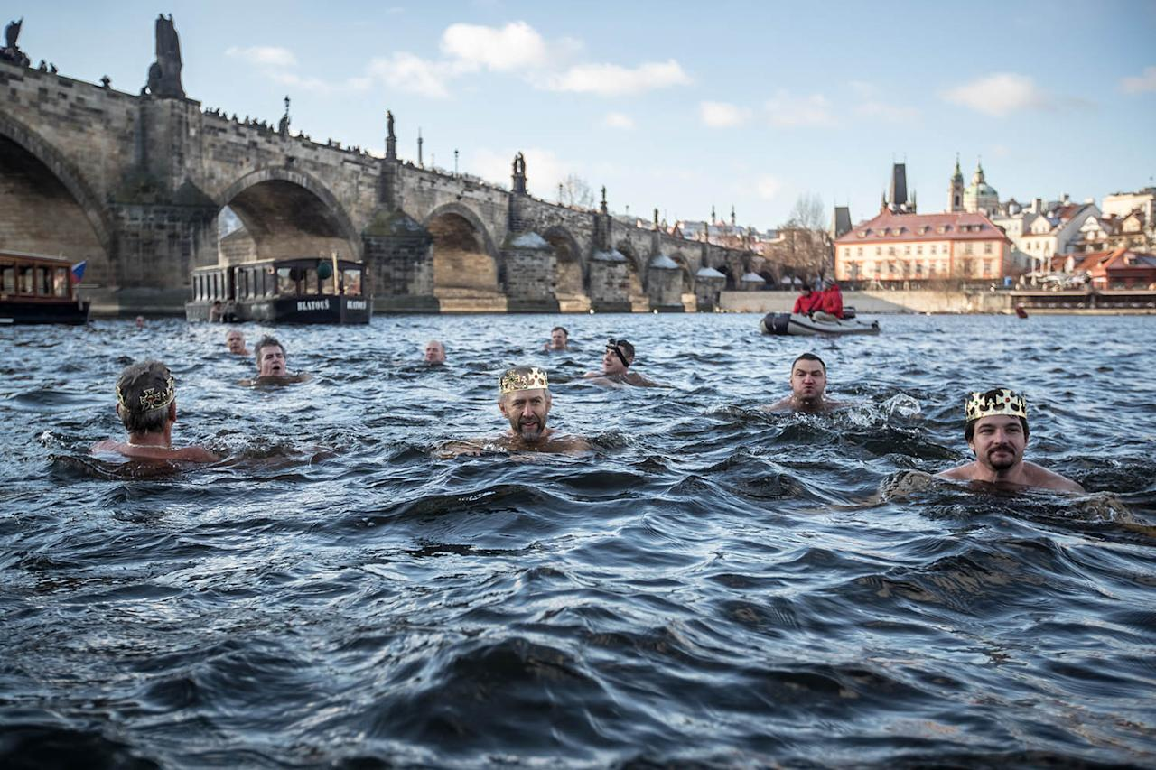 <p>Polar swimmers join the traditional Three Kings Swimming in the Vltava river in Prague, Czech Republic, Jan. 6, 2017. (Photo: MARTIN DIVISEK/EPA) </p>