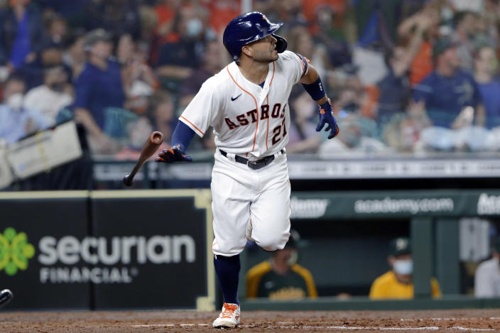 Houston Astros' Jose Altuve flips his bat as he watches his home run during the seventh inning of the team's baseball game against the Oakland Athletics on Thursday, April 8, 2021, in Houston. (AP Photo/Michael Wyke)