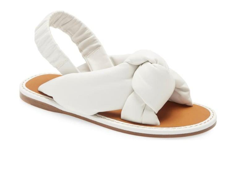 "<p>These sandals remind us of little clouds.</p> <p><a href=""https://www.popsugar.com/buy/Miu-Miu-Knot-Slingback-Flat-Sandal-573660?p_name=Miu%20Miu%20Knot%20Slingback%20Flat%20Sandal&retailer=shop.nordstrom.com&pid=573660&price=750&evar1=fab%3Aus&evar9=47446893&evar98=https%3A%2F%2Fwww.popsugar.com%2Ffashion%2Fphoto-gallery%2F47446893%2Fimage%2F47463211%2FMiu-Miu-Knot-Slingback-Flat-Sandal&list1=sandals%2Cshoes%2Cmiu%20miu%2Ctrends%2Csummer%2Cfashion%20shopping&prop13=api&pdata=1"" class=""link rapid-noclick-resp"" rel=""nofollow noopener"" target=""_blank"" data-ylk=""slk:Miu Miu Knot Slingback Flat Sandal"">Miu Miu Knot Slingback Flat Sandal</a> ($750)</p>"