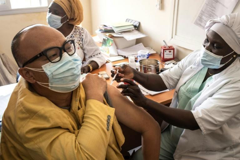 A man gets a dose of the Oxford/AstraZeneca vaccine against Covid-19 at Ngor Clinic in Dakar