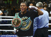 Devin Haney celebrates after defeating Jorge Linares by unanimous decision in the WBC lightweight title boxing match on Saturday, May 29, 2021, in Las Vegas. (AP Photo/Chase Stevens)