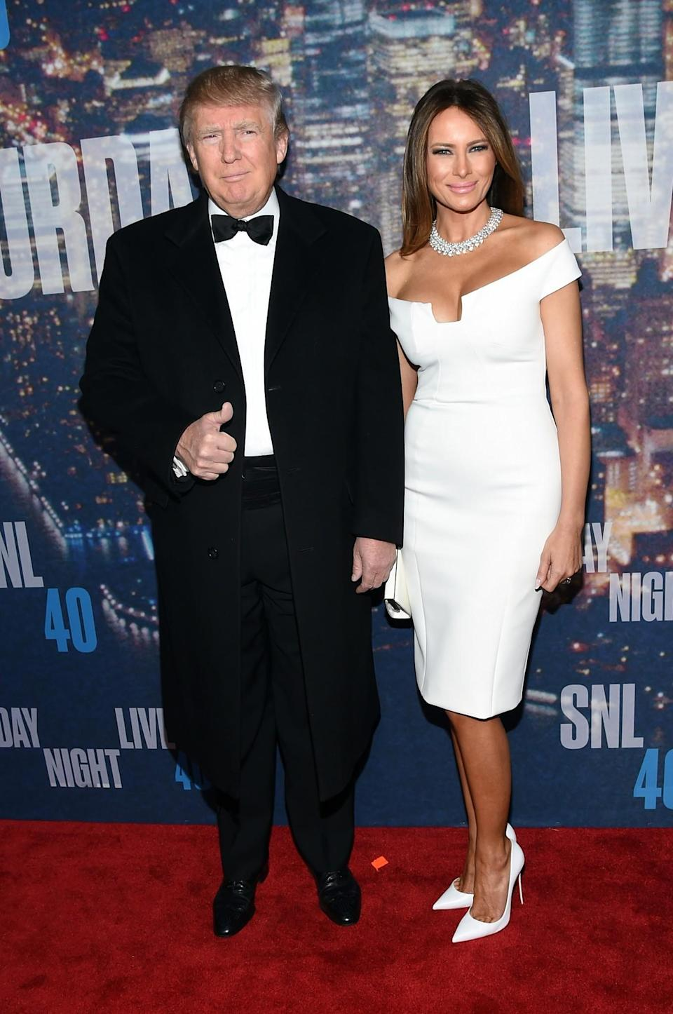 <p>For the 40th anniversary celebrations of SNL, Melania stood out in a pure white off-the-shoulder dress with matching heels and an enviable diamond necklace. <i>[Photo: Getty]</i> </p>