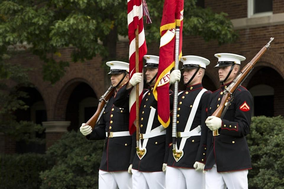 U.S. Marines with the Official Marine Corps Color Guard march on the colors during the Beirut Memorial Parade at Marine Barracks Washington, Washington, D.C., Oct. 23, 2017