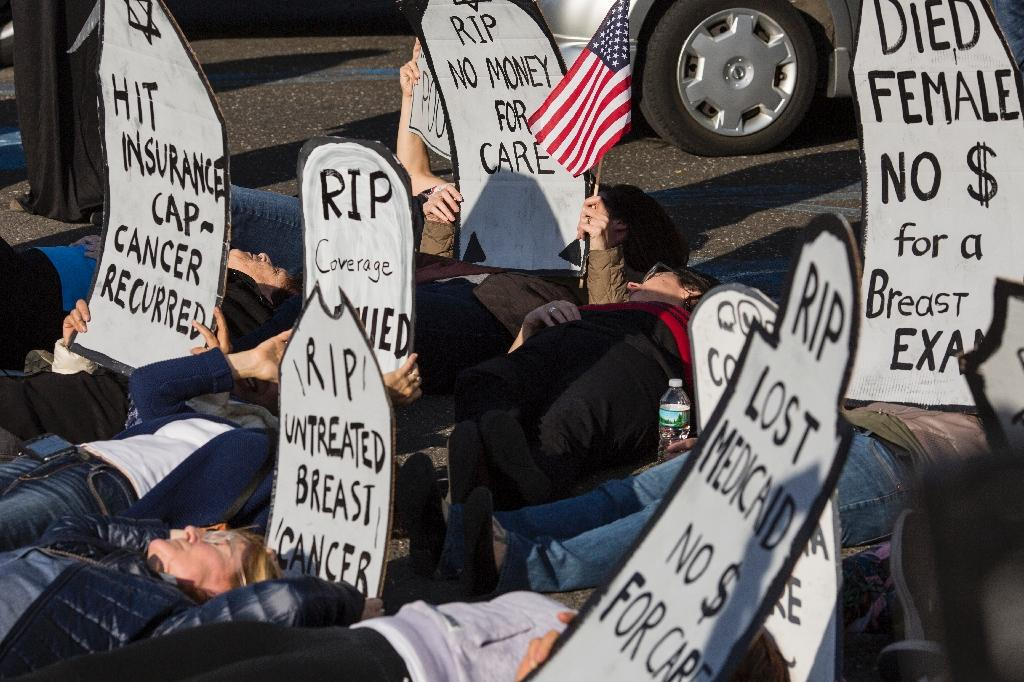 "Demonstrators stage a ""die-in"" before a town hall meeting with US Representative Tom MacArthur in New Jersey in protest at proposed health care law changes (AFP Photo/DOMINICK REUTER)"