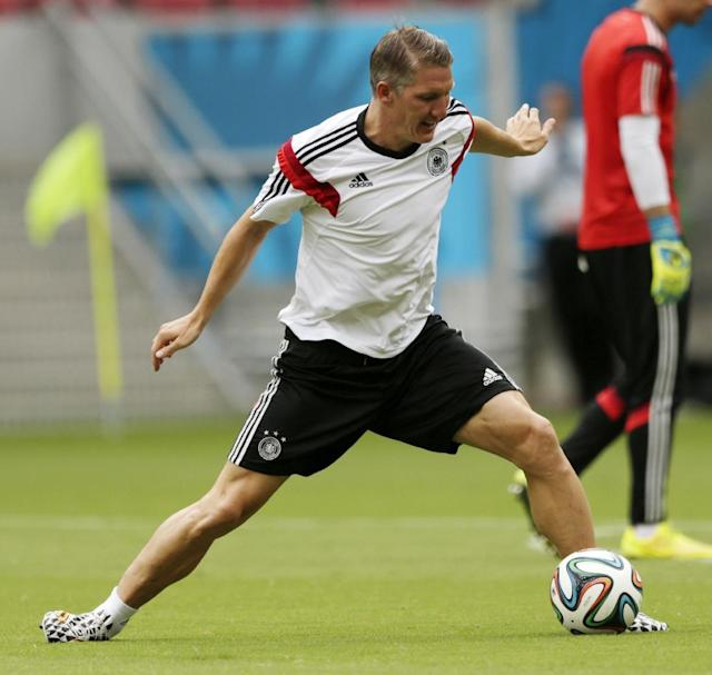 Germany's Bastian Schweinsteiger works out during a training session in Recife, Brazil, Wednesday, June 25, 2014. Germany will play the United States in group G of the 2014 soccer World Cup on June 26. (AP Photo/Julio Cortez)