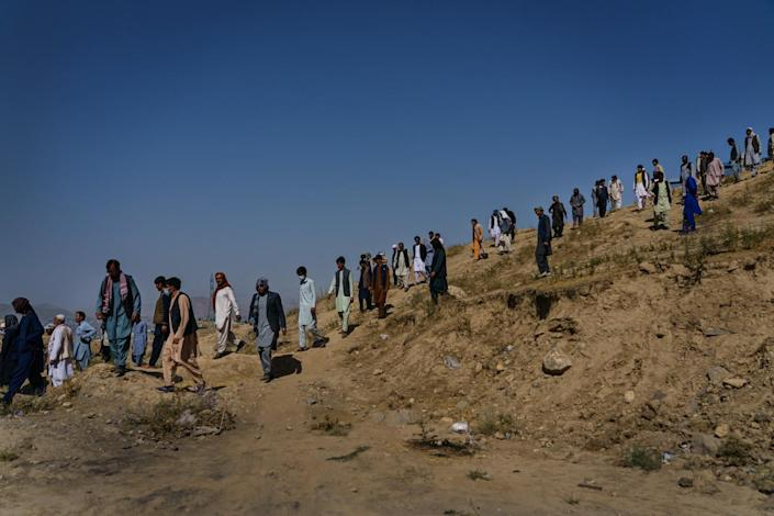 Relatives walk down Martyrs Hill after a funeral for Mushtaq.